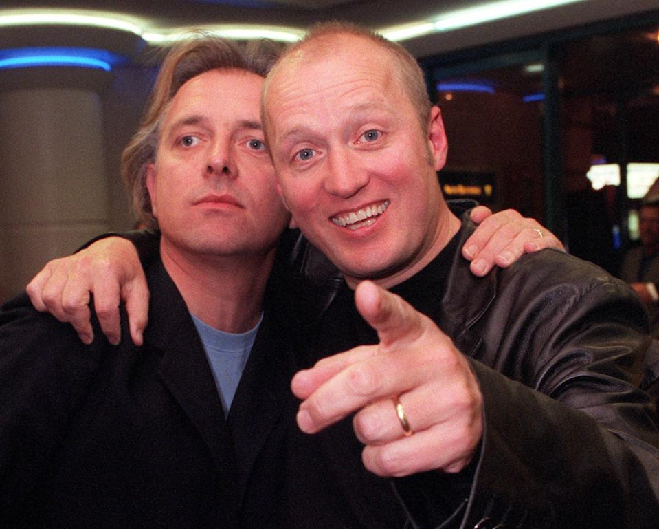 Actors and comedians Rik Mayall (left) and Ade Edmondson, who star in the film, arrive for the celebrity screening of Guest House Paradiso, at the Warner Village Cinema in Leicester Square, London.