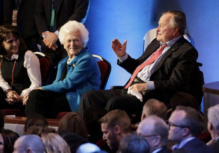 Former President George H. W. Bush, right, and his wife, Barbara Bush, center, are greeted before a Republican presidential primary debate at The University of Houston, Thursday, Feb. 25, 2016, in Houston. (Photo: David J. Phillip/AP)