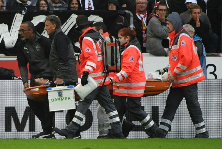 Stuttgart midfielder Christian Gentner is stretchered off during his side's Bundesliga game against VfL Wolfsburg in Stuttgart, southern Germany on September 16, 2017