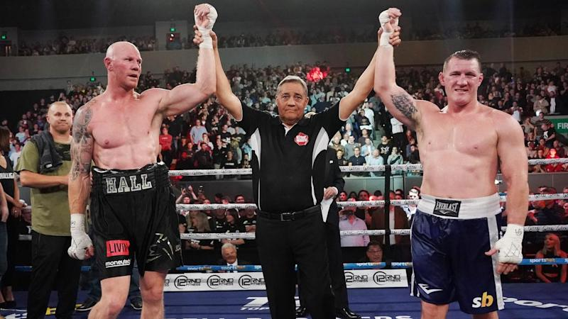 Barry Hall and Paul Gallen's (right) boxing bout in Melbourne has been declared a draw