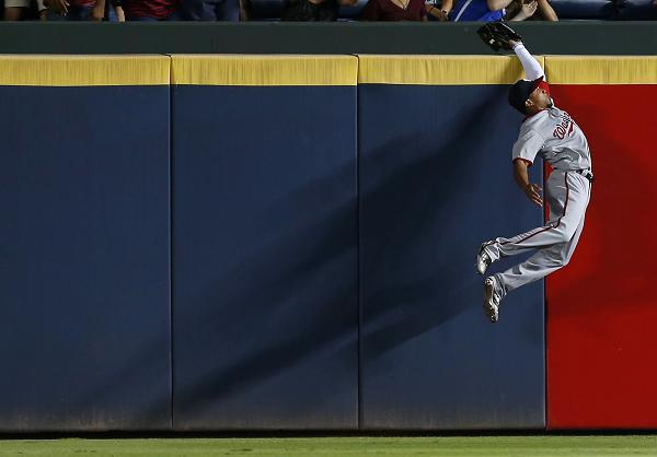 Ben Revere rises up to rob Freddie Freeman of a home run (Getty Images)