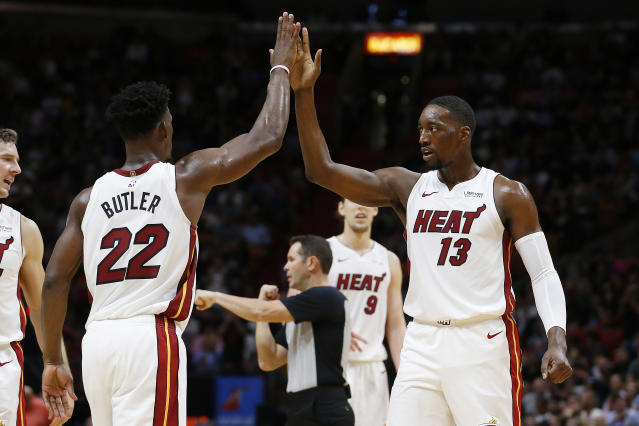Heat star Jimmy Butler has a unique bet with teammate Bam Adebayo (13). (Photo by Michael Reaves/Getty Images)