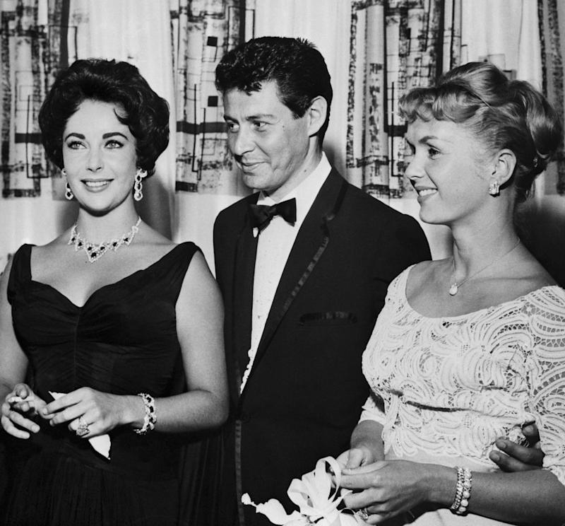 """Singer Eddie Fisher was married to<a href=""""http://www.foxnews.com/entertainment/2010/09/24/scandalous-love-triangle-time/"""">America's sweetheart, Debbie Reynolds,</a>when he<a href=""""http://www.dailymail.co.uk/tvshowbiz/article-1268158/Debbie-Reynolds-losing-husband-Eddie-Fisher-Elizabeth-Taylor.html"""">began an affair</a>with Elizabeth Taylor. He and Taylor became romantically involved in 1958 after<a href=""""http://www.cbsnews.com/8301-31749_162-20046190-10391698.html"""">bonding over the mutual loss of Mike Todd</a>-- Fisher's close friend and Taylor's late husband.<a href=""""http://www.cbsnews.com/8301-31749_162-20017578-10391698.html"""">Fisher divorced Reynolds</a>and<a href=""""http://www.cbsnews.com/8301-31749_162-20046190-10391698.html"""">tied the knot</a>with Taylor in 1959.<br /><br />Reynolds and Taylor's close friendship took an obvious hit after the affair.""""We were friends for years and years,"""" Reynolds<a href=""""http://abcnews.go.com/Entertainment/debbie-reynolds-opens-time-elizabeth-taylor-stole-husband/story?id=28347271"""" target=""""_blank"""">told People magazine</a>in 2015.""""But we had a lapse of time when she took Eddie to live with her because she liked him, too. She liked him well enough to take him without an invitation!"""""""