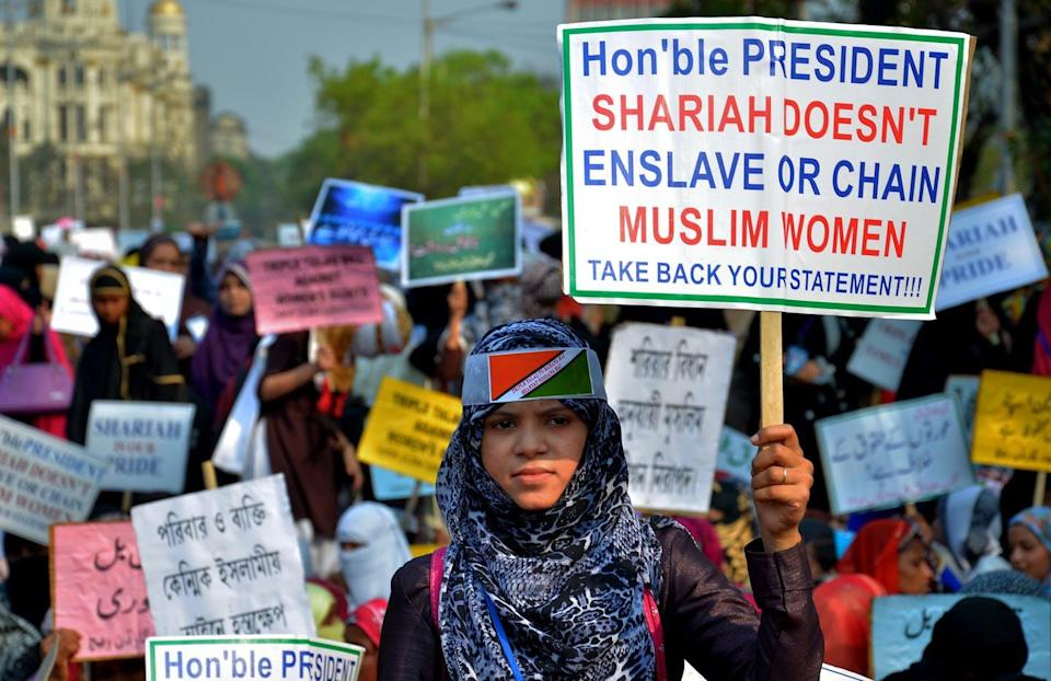 """<span class=""""caption"""">Muslim women in India protesting against the use of Sharia as a tool for oppression.</span> <span class=""""attribution""""><a class=""""link rapid-noclick-resp"""" href=""""https://www.gettyimages.com/detail/news-photo/indian-muslim-womens-hold-placards-and-take-part-in-a-news-photo/928329674?adppopup=true"""" rel=""""nofollow noopener"""" target=""""_blank"""" data-ylk=""""slk:anjay Purkait/Pacific Press/LightRocket via Getty Images"""">anjay Purkait/Pacific Press/LightRocket via Getty Images</a></span>"""