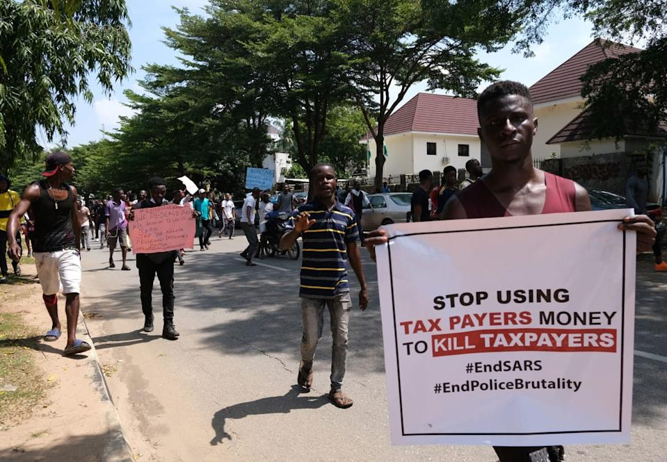 "<div class=""inline-image__caption""><p>Protesters carry banners during a demonstration to press for the scrapping of Special Ant-Robbery Squad (SARS) on Abuja-Keffi Expressway, Abuja, Nigeria on October 19, 2020. </p></div> <div class=""inline-image__credit"">KOLA SULAIMON/AFP via Getty Images</div>"