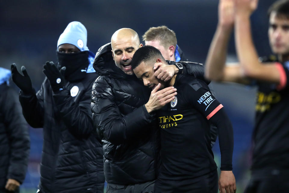 Pep Guardiola embraces Jesus after his performance (Martin Rickett/PA Wire)