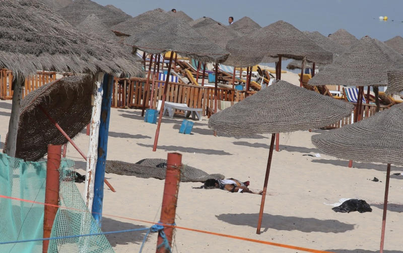The corpse of a suicide bomber, who blew himself up, lies on a beach near the tourist resort of Sousse