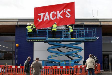 Workers unveil the branding at Tesco's new discount supermarket Jack's, in Chatteris, Britain, September 19, 2018. REUTERS/Chris Radburn