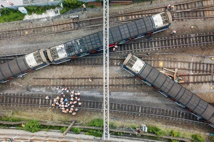 Three carriages left the tracks and were zigzagged across the rails near Hung Hom station in Kowloon, Hong Kong (AFP Photo/Anthony WALLACE)