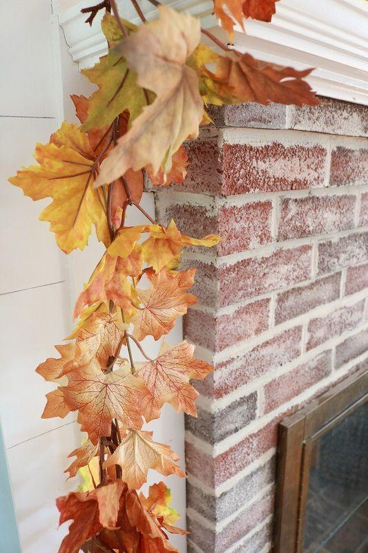 """<p>To bring fall leaves indoors without actually bringing fall leaves indoors, turn to the faux versions to create this garland for your fireplace.</p><p><strong>Get the tutorial at <a href=""""https://aboxoftwine.com/how-to-make-a-fall-leaf-garland/"""" rel=""""nofollow noopener"""" target=""""_blank"""" data-ylk=""""slk:A Box of Twine"""" class=""""link rapid-noclick-resp"""">A Box of Twine</a>.</strong></p><p><a class=""""link rapid-noclick-resp"""" href=""""https://go.redirectingat.com?id=74968X1596630&url=https%3A%2F%2Fwww.walmart.com%2Fip%2FOok-Green-Floral-Wire-50-ft%2F40816876&sref=https%3A%2F%2Fwww.thepioneerwoman.com%2Fhome-lifestyle%2Fcrafts-diy%2Fg36891743%2Ffall-mantel-decorations%2F"""" rel=""""nofollow noopener"""" target=""""_blank"""" data-ylk=""""slk:SHOP FLORAL WIRE"""">SHOP FLORAL WIRE</a></p>"""