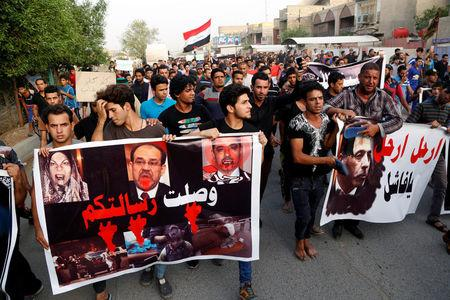 """Supporters of the prominent Iraqi Shi'ite cleric Moqtada al-Sadr shout slogans during a protest against security forces, whom they claim is not able to protect them at the site of car bomb attack yesterday in Baghdad's mainly Shi'ite district of Sadr City, Iraq, May 12, 2016. The banner reads, """"Your message has arrived"""".  REUTERS/Wissm al-Okili"""
