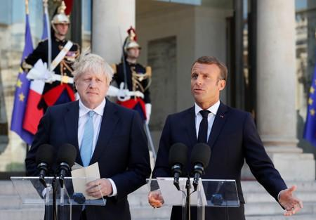 French President Emmanuel Macron and British Prime Minister Boris Johnson deliver a joint statement before a meeting on Brexit at the Elysee Palace in Paris