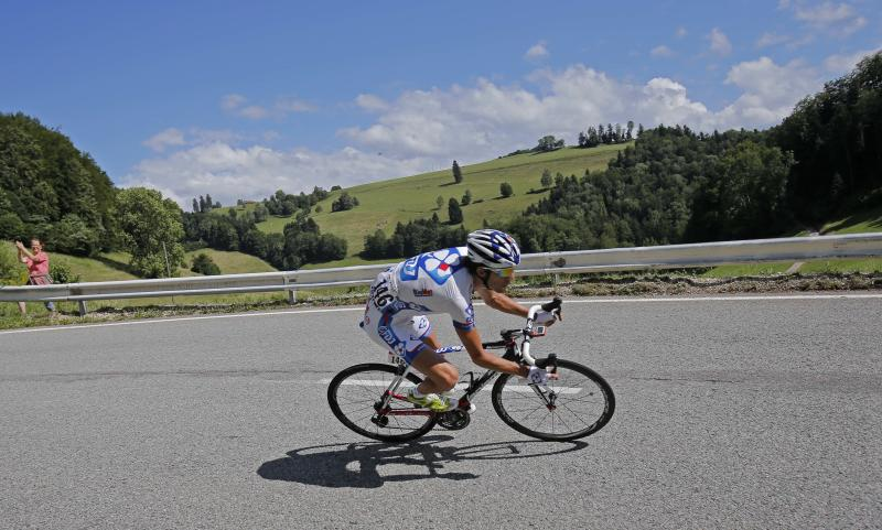 Stage winner Thibaut Pinot of France speeds down Cote de Caquerelle during the 8th stage of the Tour de France cycling race over 157.5 kilometers (98.5 miles) with start in Belfort, France, and finish in Porrentruy, Switzerland, Sunday July 8, 2012. (AP Photo/Christophe Ena)