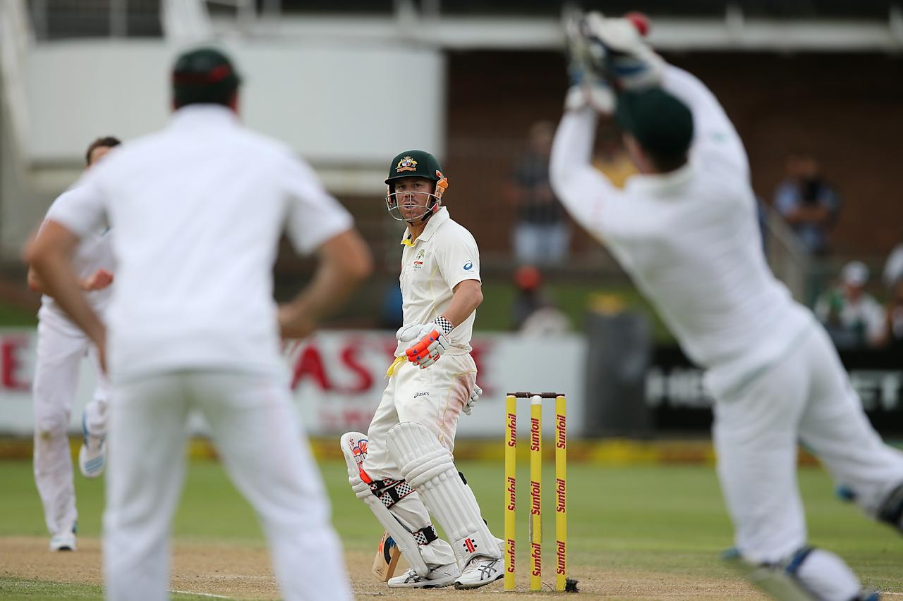 PORT ELIZABETH, SOUTH AFRICA - FEBRUARY 21: David Warner of Australia looks on as he is dropped by AB de Villiers of South Africa during day two of the Second Test match between South Africa and Australia at AXXESS St George's Cricket Stadium on February 21, 2014 in Port Elizabeth, South Africa.  (Photo by Morne de Klerk/Getty Images)