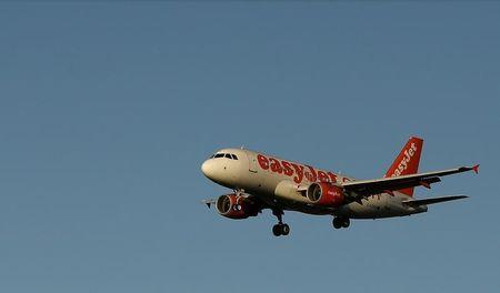 An easyJet aircraft prepares to land at Manchester Airport in northern England