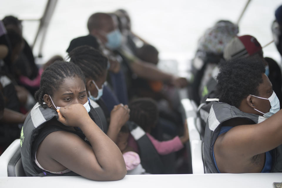 Migrants wait on a boat before departing for Capurgana, on the border with Panama, from Necocli, Colombia, Thursday, July 29, 2021. Migrants have been gathering in Necocli as they move north towards Panama on their way to the U.S. border. (AP Photo/Ivan Valencia)