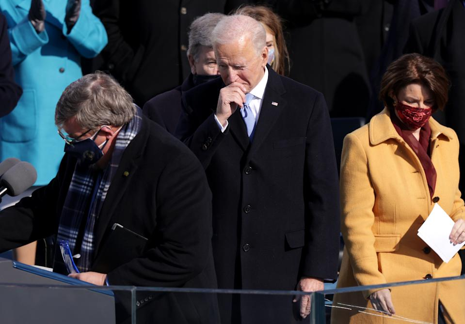 WASHINGTON, DC - JANUARY 20: U.S. President Joe Biden prepares to deliver his inaugural address on the West Front of the U.S. Capitol on January 20, 2021 in Washington, DC. During today's inauguration ceremony Joe Biden becomes the 46th president of the United States. (Photo by Alex Wong/Getty Images)