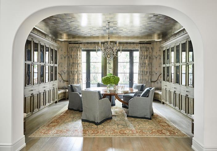 """""""Growing up, I was always in a home that had a beautiful dining room, a dining room that encouraged conversation,"""" says Rivers. """"I was really lucky to find this house that had a dining room large enough to accommodate a round table."""" Two sets of hanging cabinets were built and installed. They house special pieces including some of her mother's diamond-encrusted frames and her animals carved out of agate. Upholstered benches were added in the four corners, too, to give the room a cozier feel. """"I like that there's that extra place to perch,"""" says Rivers."""