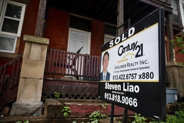 A 'sold' sign sits in front of a residential property in Ottawa in August 2020 when the pandemic housing market was heating up. (Andrew Lee/CBC - image credit)