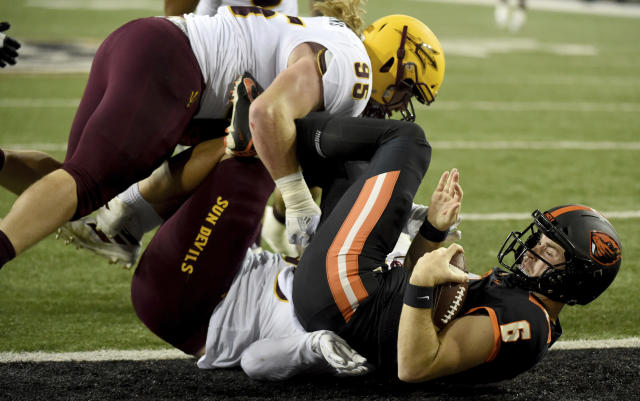 Oregon State quarterback Jake Luton (6) is sacked by Arizona State defensive linemen Jermayne Lole and Roe Wilkins during the first half of an NCAA college football game in Corvallis, Ore., Saturday, Nov. 16, 2019. (AP Photo/Steve Dykes)