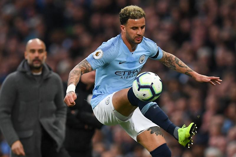 Kyle Walker (right) has become a key player for Manchester City under Pep Guardiola (left)