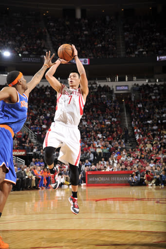 HOUSTON, TX - NOVEMBER 23: Jeremy Lin #7 of the Houston Rockets shoots the ball over Carmelo Anthony #7 of the New York Knicks on November 23, 2012 at the Toyota Center in Houston, Texas. (Photo by Bill Baptist/NBAE via Getty Images)