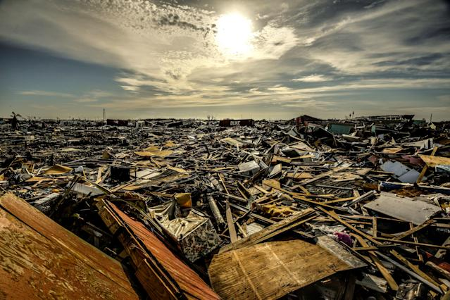 """<div class=""""caption""""> The devastation at Marsh Harbour stretched in all directions. </div> <cite class=""""credit"""">Dom Furore</cite>"""
