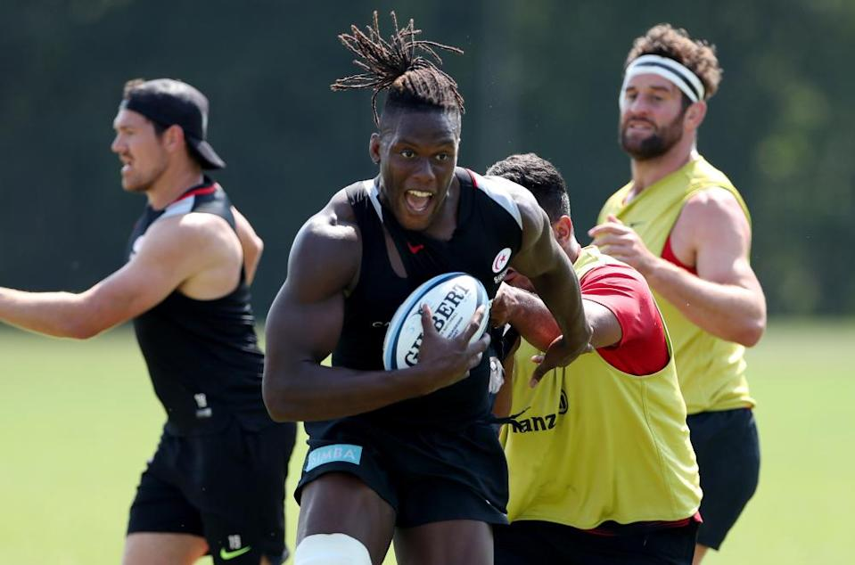 Maro Itoje runs with the ball during a Saracens training session in August.