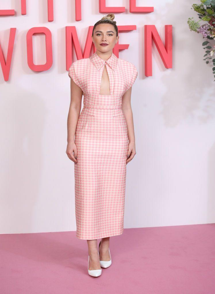 <p>Pugh wore a pink, gingham, cut-out, column midi dress to the Little Women photocall at Soho Hotel, December 2019.</p>