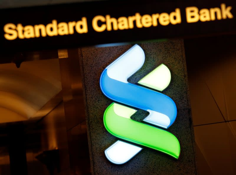FILE PHOTO: A logo of Standard Chartered is displayed at its main branch in Hong Kong