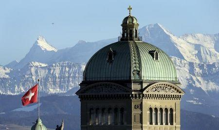 A file photo shows the Swiss Federal Palace in front of the Alps in Bern