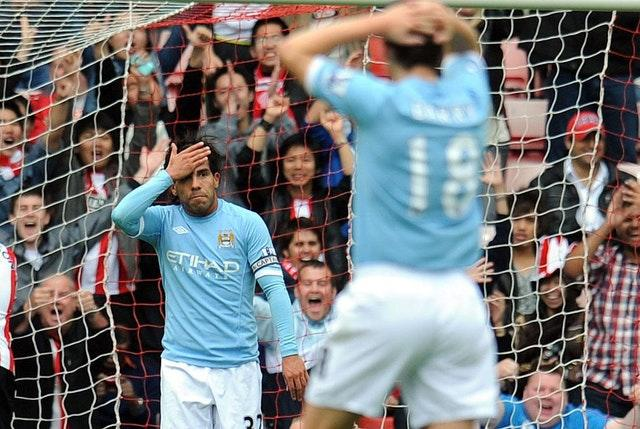 Carlos Tevez reacts to his miss