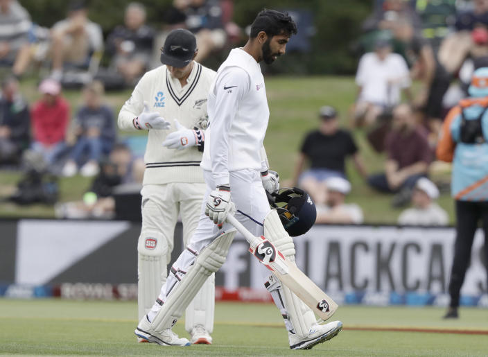 India's Jasprit Bumrah walks from the field after he was run out during play on day three of the second cricket test between New Zealand and India at Hagley Oval in Christchurch, New Zealand, Monday, March 2, 2020. (AP Photo/Mark Baker)