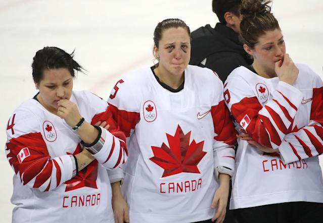 <p>Brigette Lacquette, Lauriane Rougeau and Rebecca Johnston wait their medals as Canada loses in a shootout to the United States in the Olympic women's hockey gold medal game at the Gangneung Hockey Centre in Gangneung in Pyeongchang in South Korea. February 22, 2018. (Steve Russell/Toronto Star via Getty Images) </p>
