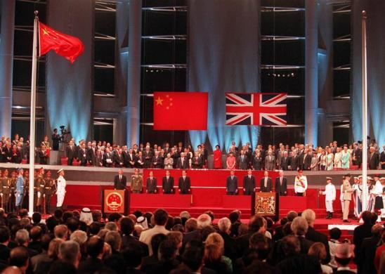A general view of the handover ceremony showing the Chinese flag (L) flying after the Union flag (R) was lowered July 1, 1997.