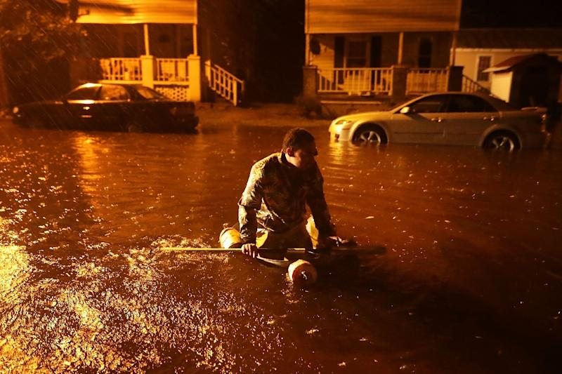 Resident Michael Nelson floats in a makeshift boat after the Neuse River flooded his street during Hurricane Florence in New Bern, North Carolina