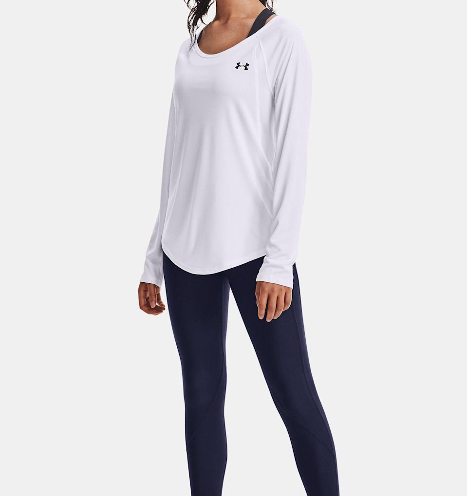"""<p><strong>UnderArmour</strong></p><p>underarmour.com</p><p><strong>$26.99</strong></p><p><a href=""""https://go.redirectingat.com?id=74968X1596630&url=https%3A%2F%2Fwww.underarmour.com%2Fen-us%2Fp%2Ftops%2Fwomens-ua-sun-armour-long-sleeve%2F1363439.html&sref=https%3A%2F%2Fwww.prevention.com%2Fbeauty%2Fstyle%2Fg36320853%2Fbest-sun-protective-clothing%2F"""" rel=""""nofollow noopener"""" target=""""_blank"""" data-ylk=""""slk:Shop Now"""" class=""""link rapid-noclick-resp"""">Shop Now</a></p><p>Despite looking and feeling like a regular shirt, this long-sleeve top from Under Armour has built-in <strong>UPF 50+ sun protection</strong>. Plus, the moisture-wicking fabric will keep you cool—a perk for hot summer days.</p>"""