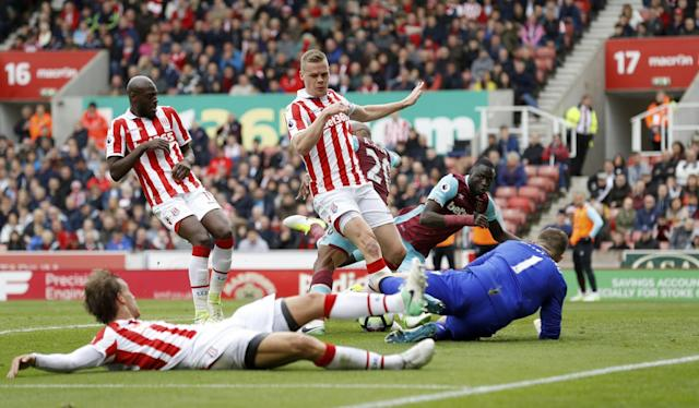 <p>West Ham United's Andre Ayew, second right, has attempt on goal blocked by Stoke City goalkeeper Jack Butland, right </p>