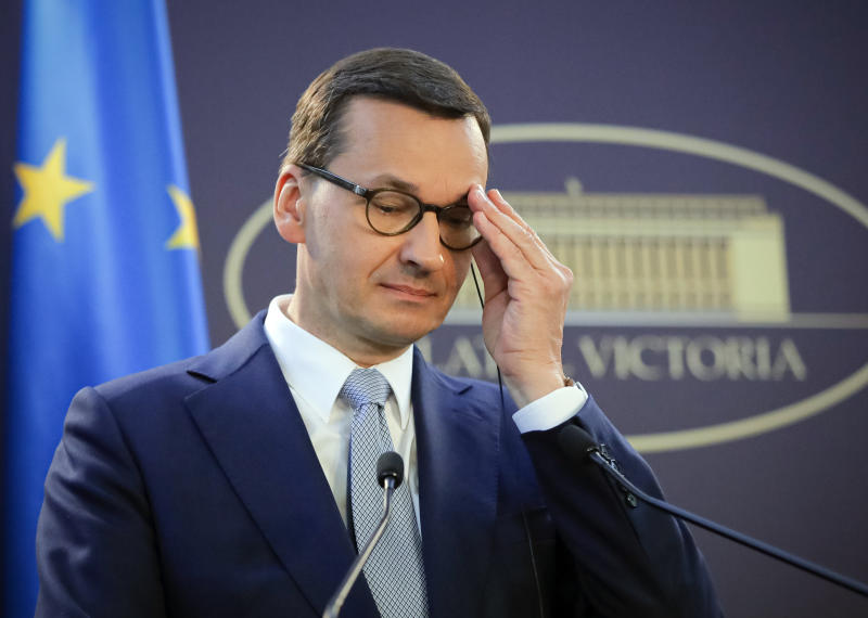 Polish Prime Minister Mateusz Morawiecki adjusts his glasses during joint press statements with Romanian counterpart Viorica Dancila, after the Romanian-Polish government meeting, at the Victoria palace, the Romanian government headquarters, in Bucharest, Romania, Wednesday, Sept. 18, 2019. (AP Photo/Vadim Ghirda)