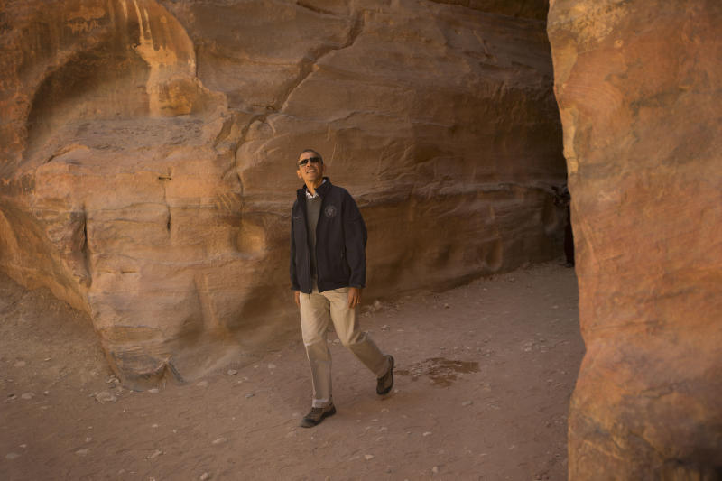 U.S. President Barack Obama looks up during his tour of the ancient city of Petra, Jordan, Saturday, March 23, 2013. (AP Photo/Pablo Martinez Monsivais)