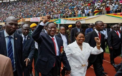 <span>Emmerson Mnangagwa and his wife Auxillia arrive at the presidential inauguration ceremony in the capital Harare, Zimbabwe</span> <span>Credit: AP </span>
