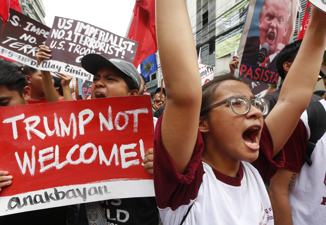 <p>Protesters rally near the U.S. Embassy in Manila to protest this weekend's visit of U.S. President Donald Trump, Friday, Nov. 10, 2017, in Manila, Philippines. (Photo: Bullit Marquez/AP) </p>