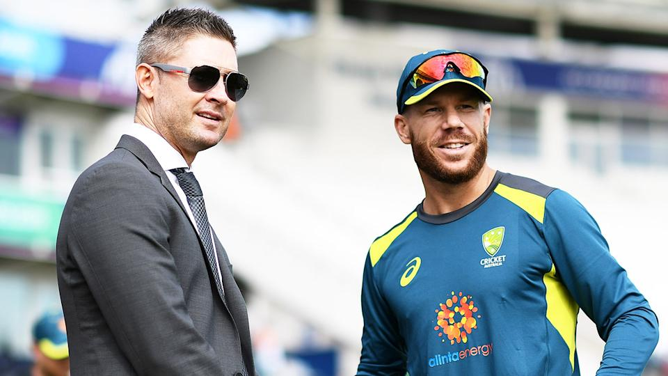 Michael Clarke (pictured left) talking to batsman David Warner (pictured right) before a match.