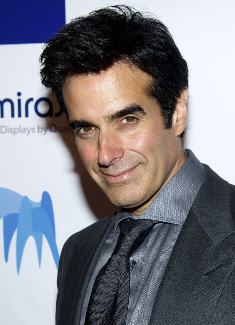 """FILE -In this May 9, 2011 file photo, magician David Copperfield attends the 46th Annual 2011 National Magazine Awards in New York. Early Monday morning, March 4, 2013, the private plane carrying Copperfield made an unscheduled stop at Peoria International Airport in Illinois after it made a """"frightening"""" sound en route from Las Vegas to New York where Copperfield was to appear on NBC's Today Show. Copperfield filmed the interview remotely from Byerly Aviation in Peoria. (AP Photo/Charles Sykes, File)"""