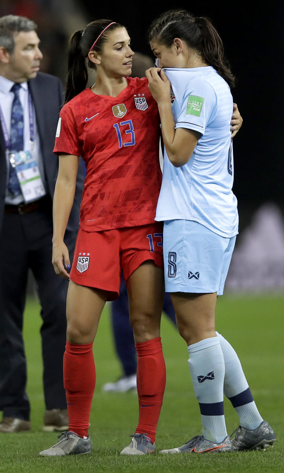 United States' Alex Morgan, left, comforts Thailand's Miranda Nild, right, after the Women's World Cup Group F soccer match between United States and Thailand at the Stade Auguste-Delaune in Reims, France, Tuesday, June 11, 2019. Morgan scored five goals during the match. (AP Photo/Alessandra Tarantino)