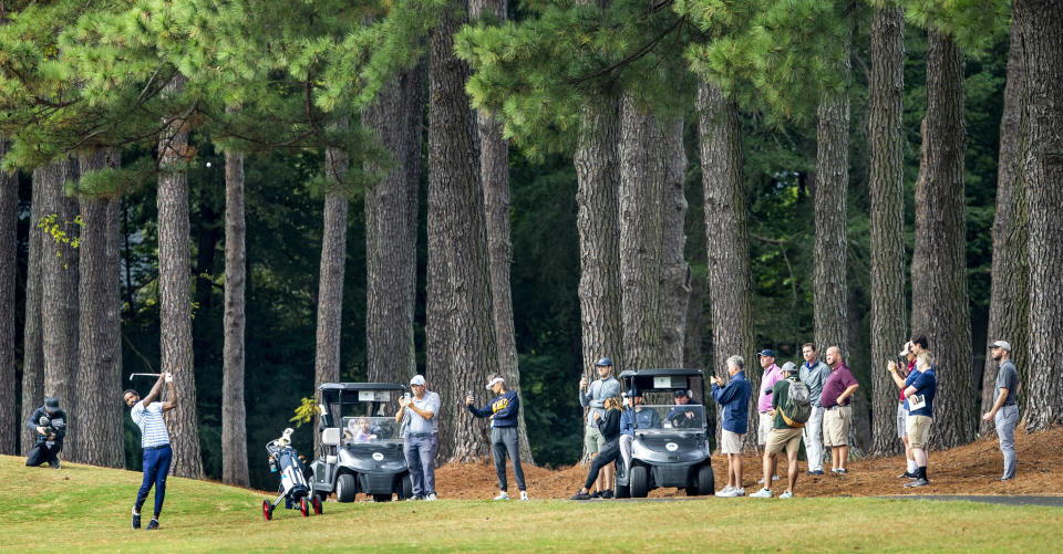 The gallery watches as North Carolina A&T's J.R. Smith hits toward the fifth green during the second round of the Phoenix Invitational golf tournament in Burlington, N.C., Tuesday, Oct. 12, 2021. Smith spent 16 years playing in the NBA, winning two world championships. (Woody Marshall/News & Record via AP)