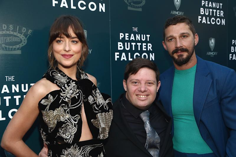 "HOLLYWOOD, CALIFORNIA - AUGUST 01: Dakota Johnson, Zack Gottsagen and Shia LaBeouf attend the LA Special Screening Of Roadside Attractions' ""The Peanut Butter Falcon"" at ArcLight Hollywood on August 01, 2019 in Hollywood, California. (Photo by Tommaso Boddi/Getty Images)"
