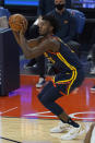 Golden State Warriors center James Wiseman shoots a 3-point basket against the Minnesota Timberwolves during the first half of an NBA basketball game in San Francisco, Wednesday, Jan. 27, 2021. (AP Photo/Jeff Chiu)