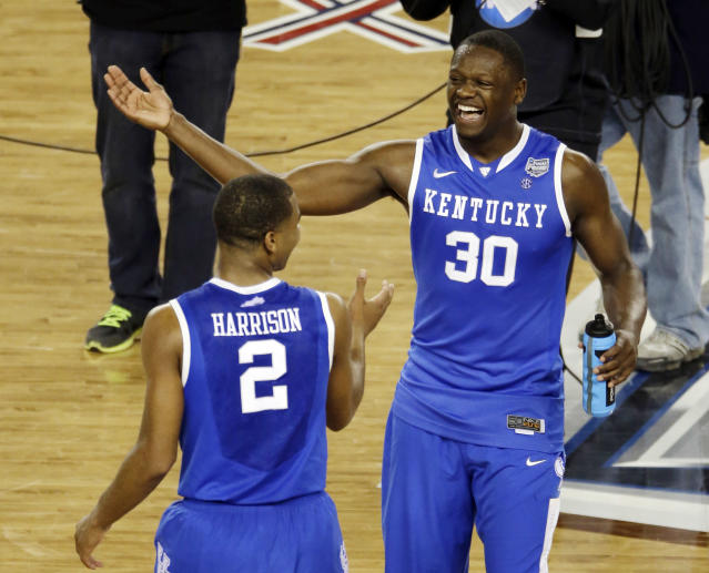 After Kentucky guard Aaron Harrison (2) made a three-point basket in the final seconds against Wisconsin to win the game 74-73, he celebrates with Julius Randle (30) at the end of their NCAA Final Four tournament college basketball semifinal game Saturday, April 5, 2014, in Arlington, Texas. (AP Photo/Tony Gutierrez)