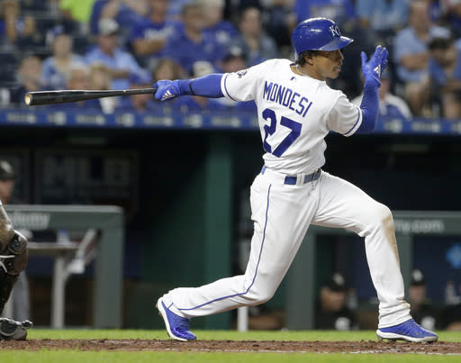 FILE - In this Sept. 12, 2018, file photo, Kansas City Royals' Adalberto Mondesi hits an RBI single during the fifth inning of a baseball game against the Chicago White Sox, in Kansas City, Mo. The arc of the Royals last season tracked closely to that of Mondesi, one of their most touted prospects in years and quite possibly the future of the organization. (AP Photo/Charlie Riedel, File)